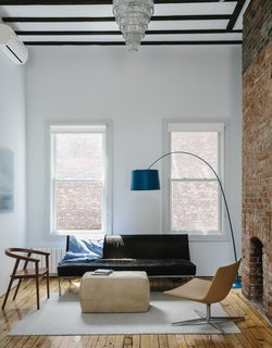 An Ad Copywriter Edits His Manhattan Row House—and Finds a New Calling - Photo 6 of 14 - On the top floor, a Cumberland chair by Thos. Moser faces a Room & Board ottoman, a Twiggy lamp by Foscarini, and a vintage sofa upholstered in cowhide.