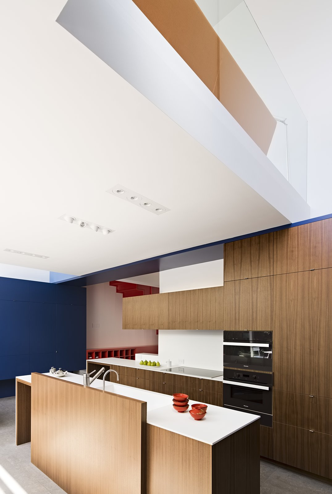Custom cabinets by Myers Cabinetry have Corian countertops.