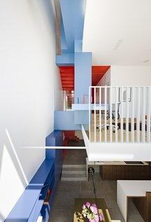 10 Dwell Projects That Were Proudly Designed by Women - Photo 9 of 10 - Three shades of paint—Kensington Blue, Old Blue Jeans, and Denim Wash, all by Benjamin Moore—cover built-ins and delineate space.