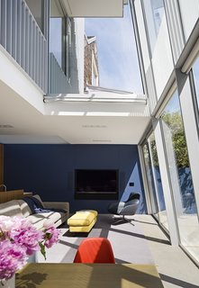 After a Renovation, a Classic San Francisco Victorian Is Now Bursting With Light and Color - Photo 5 of 15 - Working with project architect Todd Aranaz, Fougeron moved the living room to the ground floor and combined it with the dining area and kitchen. The Stoccolma sofa and ottoman <br>are by Paola Navone for Baxter.