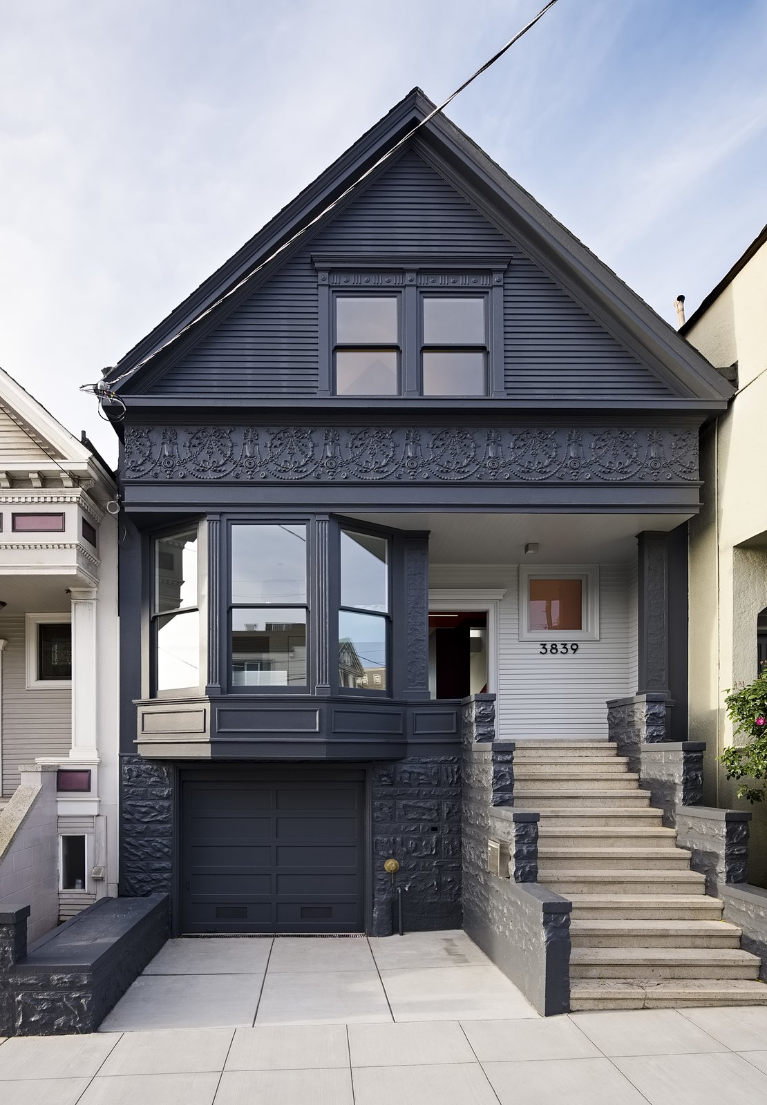 The facade's historical details were preserved and painted Gunmetal by Benjamin Moore. Tagged: Exterior, Wood Siding Material, House, and Gable RoofLine.  Photo 7 of 16 in After a Renovation, a Classic San Francisco Victorian Is Now Bursting With Light and Color