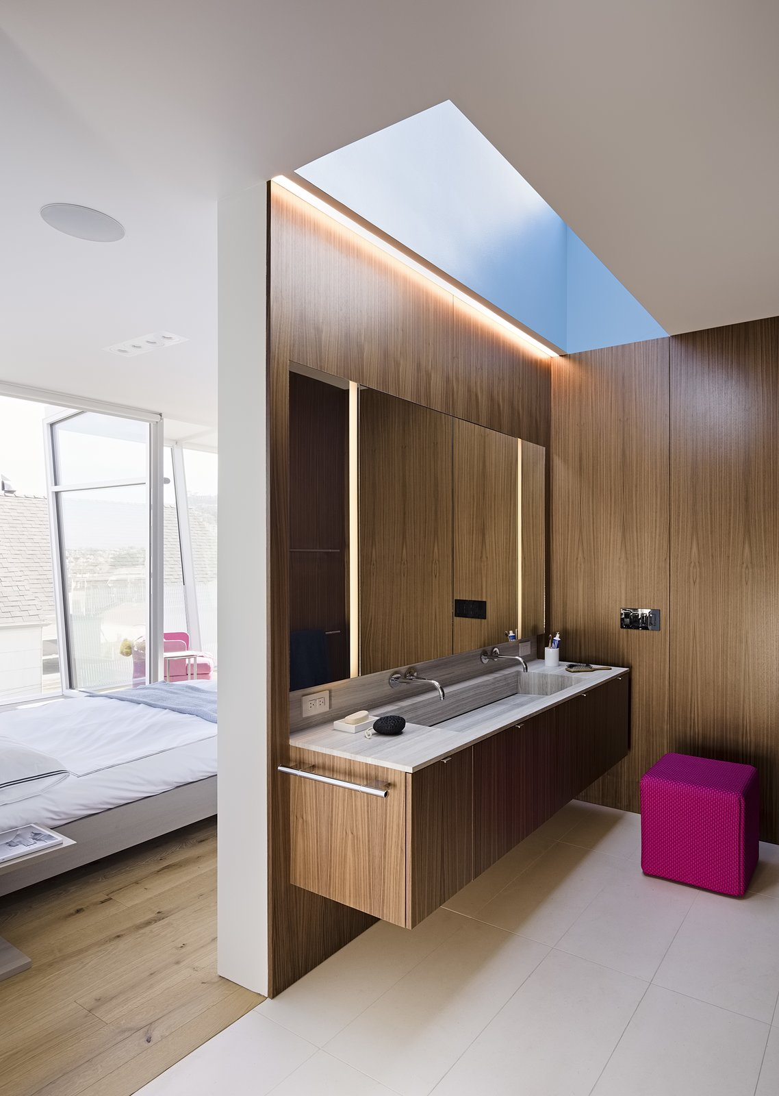 During the day, a skylight illuminates the master bathroom.