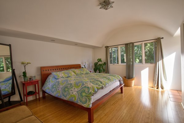 The main bedroom has a generous closet and outdoor access.
