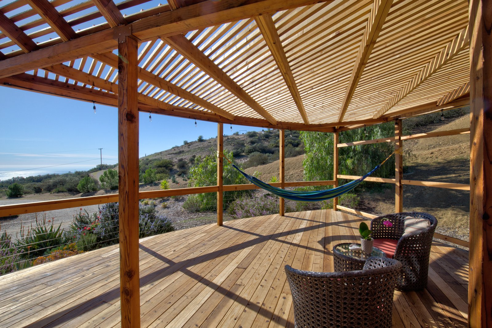 The deck has multiple lounge spaces, including two hammocks, and would make for an inspiring, open-air yoga studio.