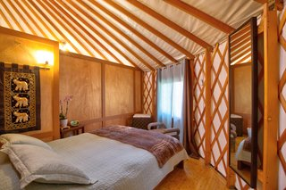 This Santa Barbara Yurt Is the Ultimate Place to Recharge - Photo 6 of 9 - The smaller bedroom is tucked behind a partition for privacy.