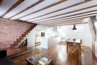 An Ad Copywriter Edits His Manhattan Row House—and Finds a New Calling - Photo 8 of 14 - Custom finishes in anodized aluminum meet original exposed ceiling beams and brick walls in the kitchen.