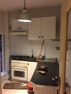 Before and After: An Ancient Barcelona Apartment Gets a Colorful, Chic Makeover - Photo 4 of 24 - The original kitchen.
