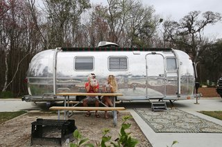 Before and After: A Couple Revamp an Old Airstream Into a Charming Workspace and Home