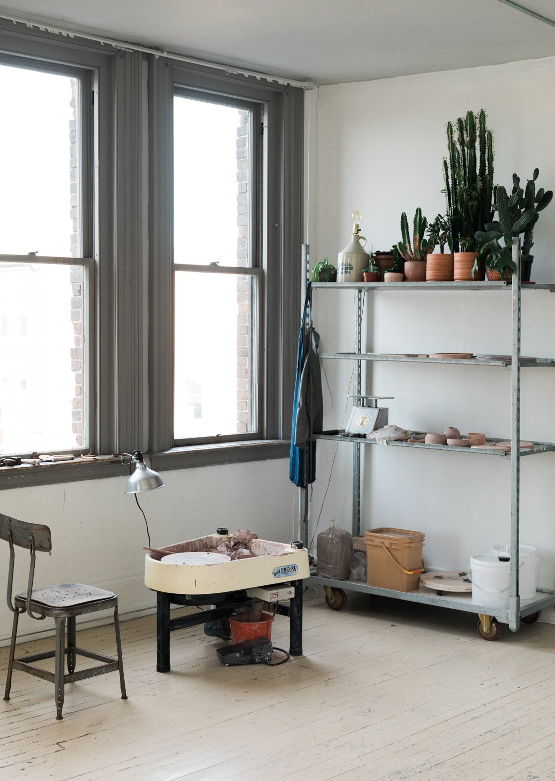 In one corner of the studio, Spellman has an area dedicated to ceramics, as pictured above.
