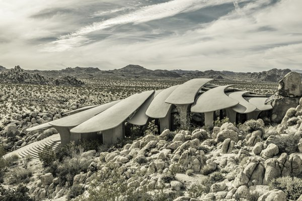 The Desert House is about 40 miles outside of Palm Springs, sited on a pile of boulders at the edge of Joshua Tree National Park, and it was finished in the early 2000s, long after the heyday of post-and-beam modernism. Yet there may not be another residence more attuned to the hardened landscape of the Coachella Valley than Kendrick Bangs Kellogg's most outré experiment in organic architecture.