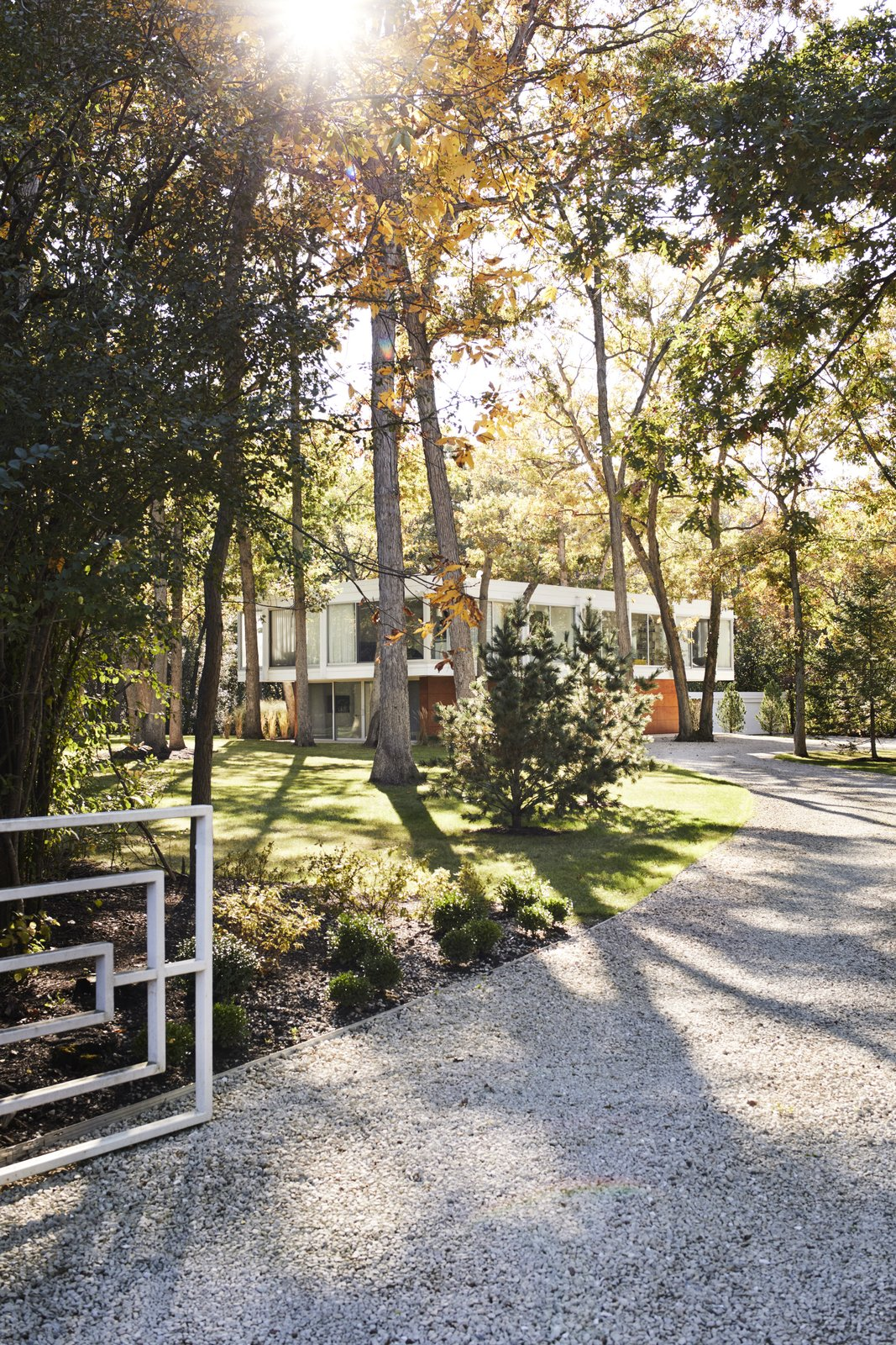 Taking an active role in the restoration of a midcentury house she and her husband bought near Chicago in 2013, Eva Kowalow honored the vision of the home's architect and previous owner, Jack Viks, while updating the structure to fit her style and the needs of her family. The entrance gate, designed by Viks, is original.