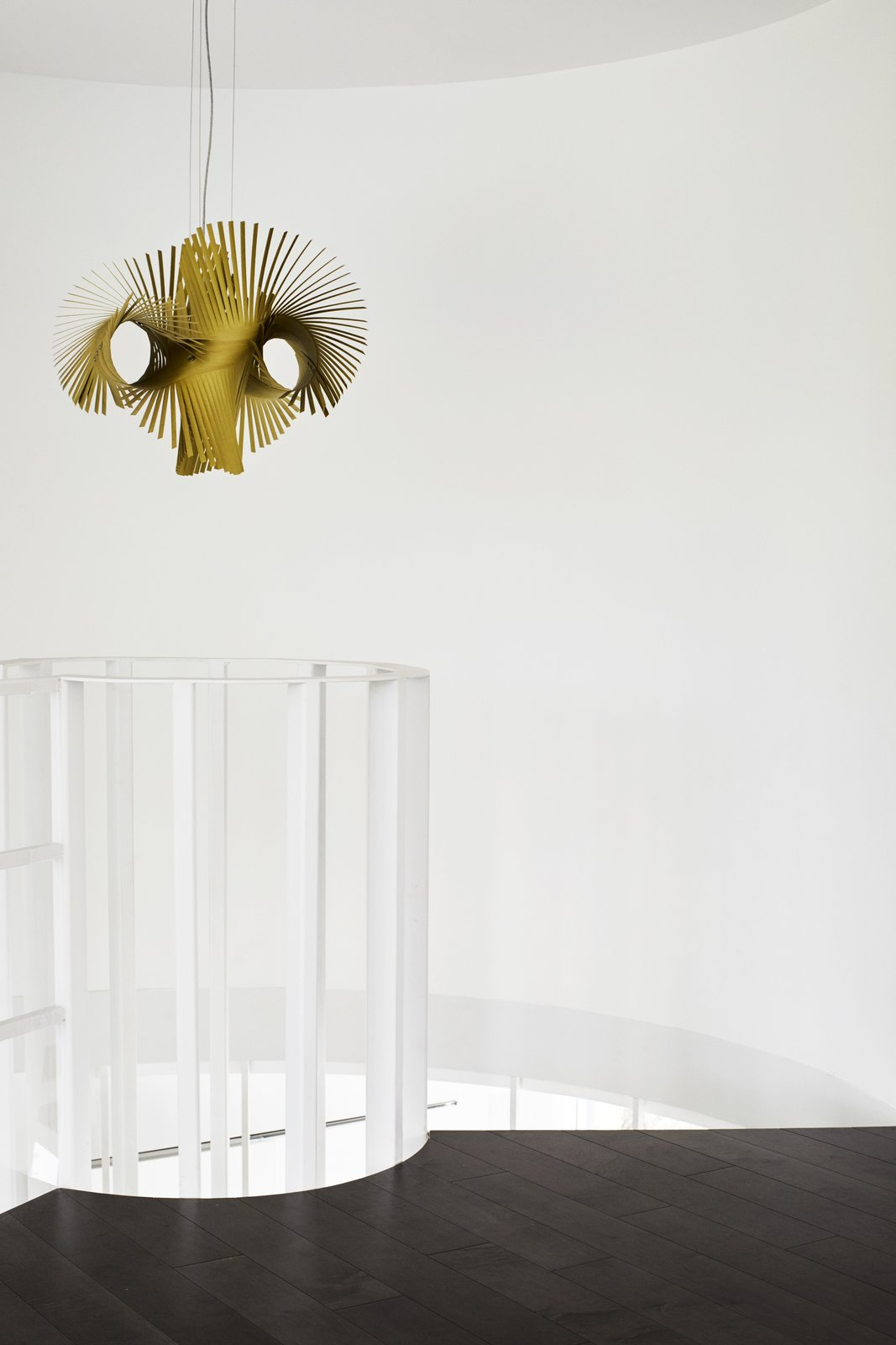 A Minimikado light from Lzf Lamps hangs at the top of the staircase.