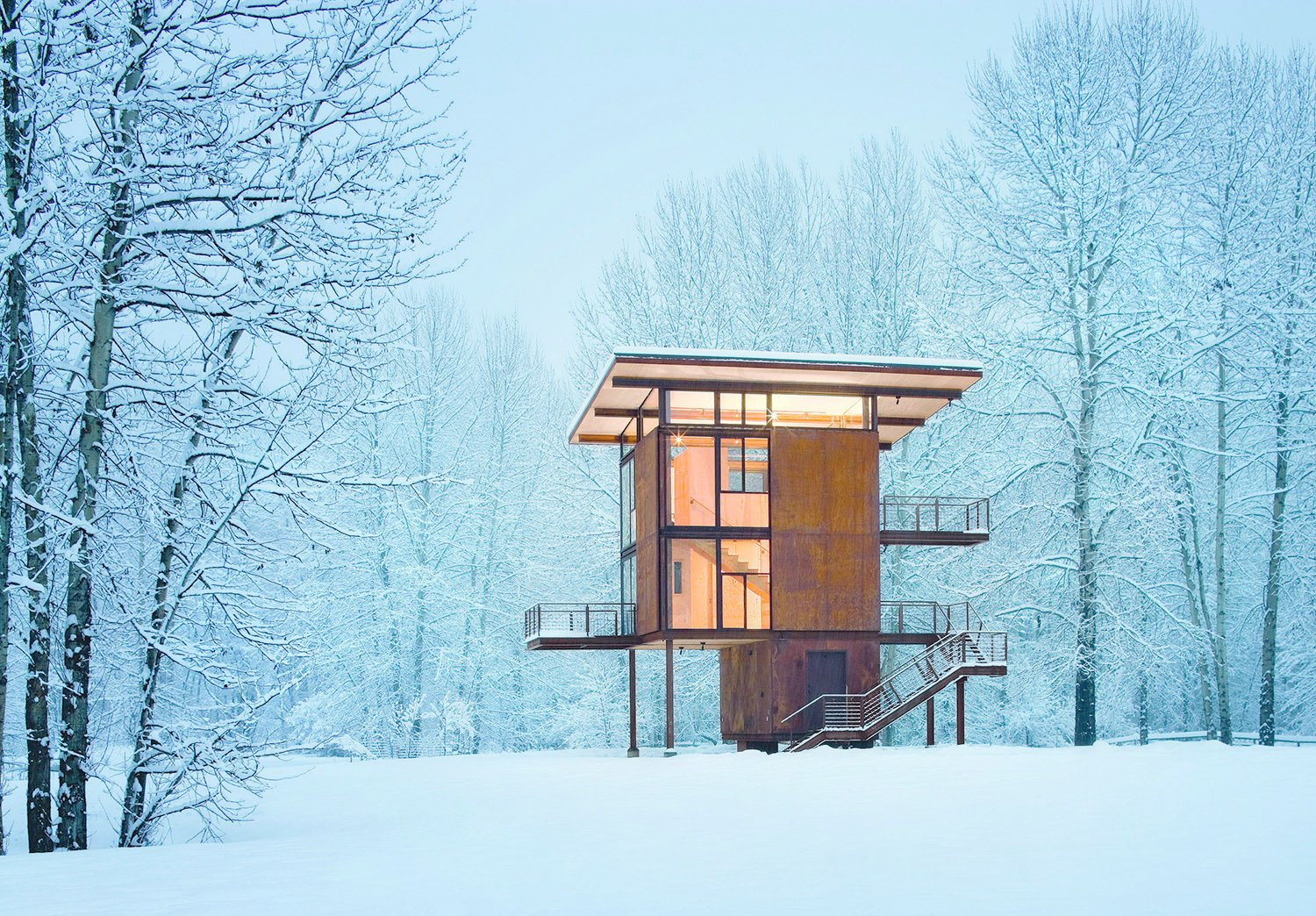 Olson Kundig Architects' Delta Shelter, in Mazama, Washington, is a 1,000 square-foot steel box home with a 200 square-foot footprint. Photo by Olson Sundberg Kundig Allen Architects/TASCHEN. Off the grid by Michela O'Connor Abrams