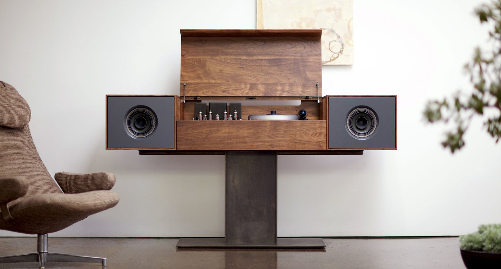 """The flagship of the Symbol audio line, the Modern Record Console pays homage to ""all in one"" console hifi's of the 1950's, an idea whose time, we believe, has come around again. Each cabinet is individually crafted in the tradition of fine bench-made furniture from solid American Walnut. The sculptural metal base is constructed from 1/4"" plate steel and hand patinated to create a warm natural finish. As a piece of furniture the MRC will undoubtedly become a focal point of any interior."" - SYMBOL audio Photo: Symbol Audio http://shop.symbolaudio.com/pages/modern-record-console"