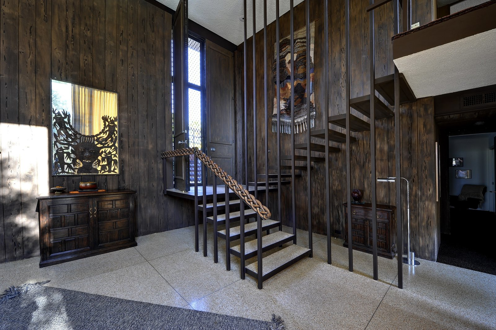 Follow in the footsteps of Steve McQueen as you take the stairs either down to the living space or up to the bedroom.
