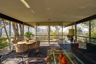 Live Like Steve McQueen for a Cool 2.5 Million Dollars - Photo 3 of 6 - Enjoy sweeping vistas of the San Jacinto Mountain range and downtown Palm Springs just like Steve did. While you're at it, try contemplating the pattern of the rug by Edward Fields, if you can.