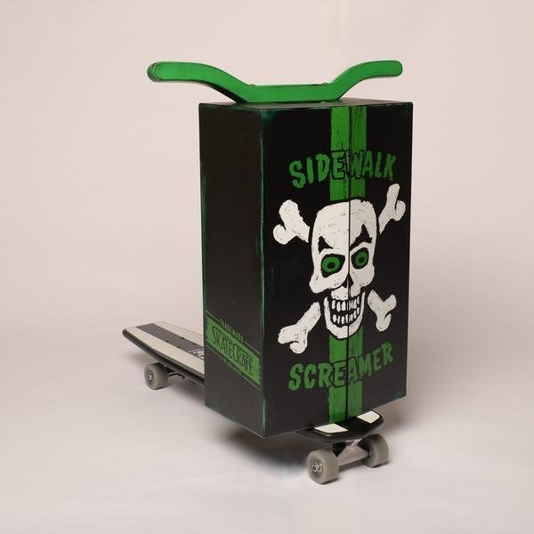 "Skate Crate: ""This is the black sheep of the Skate Crate family. This ""Land Pirate"" design is sure to make people tremble in fear.  It features an ""aged"" paint job with green trim and painted green upturned handle bars (not shown), and a carrying handle on top. "" http://skate-crate.myshopify.com/  Modern Skate by Stephen Blake"