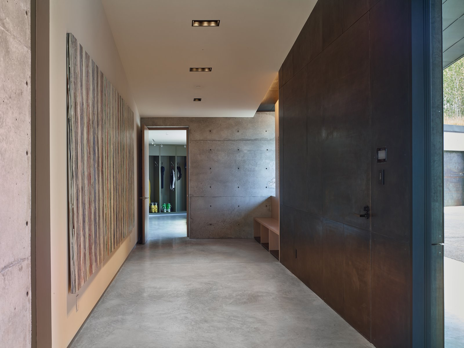 The client possessed a collection of art to be placed in the home, which was meticulously considered in the design process. Drywall was used exclusively and deliberately to hang the artwork to each piece's necessary measurement.  Tagged: Hallway and Concrete Floor.  Wyoming Residence by Abramson Teiger Architects