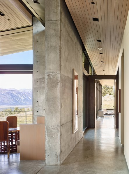 Once inside, natural light serves as an important material layered amongst its solid counterparts. Wood ceilings sit slightly pulled back from the walls to create a feeling of expansiveness.  Photo 5 of Wyoming Residence modern home