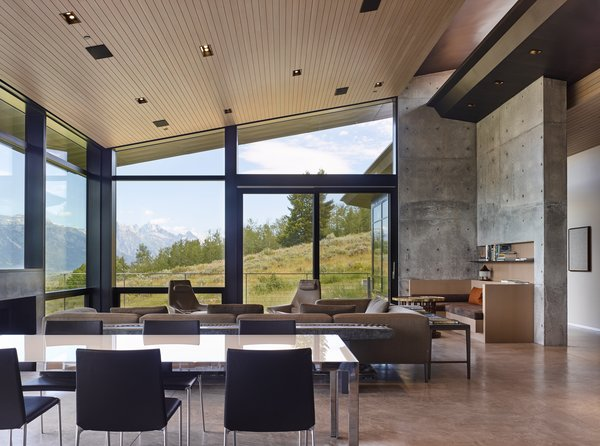 Floor-to-ceiling windows unveil a view of the stunning exterior scenery.