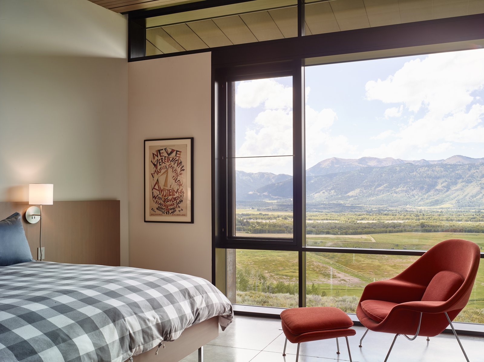 Windows in the guest bedrooms allow the ceiling to rest gently.  Tagged: Bedroom, Bed, and Chair.  Wyoming Residence by Abramson Teiger Architects