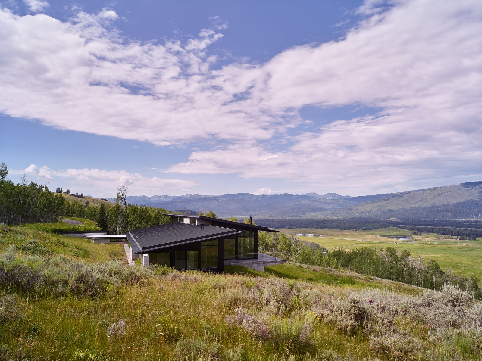 With respect to the sloping meadow, the home is designed to coexist and therefore never breaks the ridgeline.  Wyoming Residence by Abramson Teiger Architects