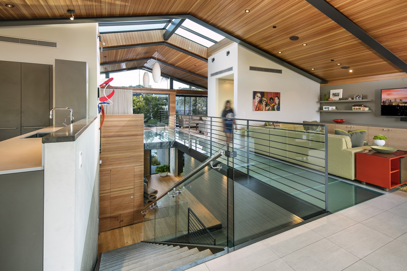 The space is configured as a loft-like modern treehouse with an inverted floorplan, positioning the primary living spaces on the top floor for maximum light exposure.  Cohen Residence by Abramson Teiger Architects