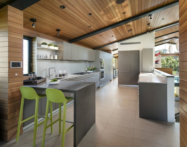 The minimal kitchen features a breakfast bar.  Photo 6 of Cohen Residence modern home