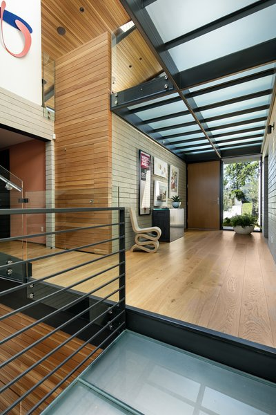 Translucent walkways keep an open concept feel.  The client's art collection adds a playful touch.  Photo 9 of Cohen Residence modern home