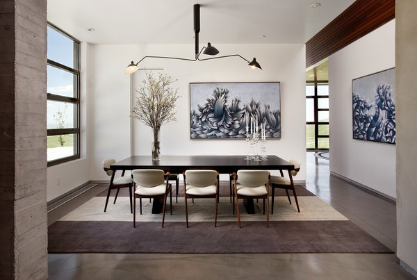 A striking dining room weaves Mid-Century with a classic sophistication.  Photo 7 of Casper Residence modern home