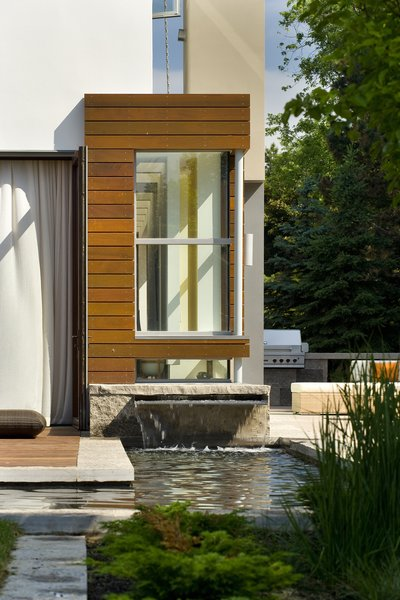 A water feature allows the patio and garden to float lightly.   Photo 3 of Davis Residence modern home