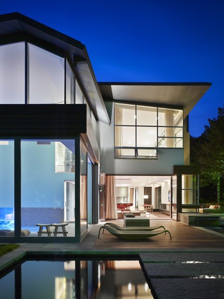 Natural light was central to the design, and the ATA design team implemented skylights, sliding doors and large scale windows throughout.   Photo 4 of Davis Residence modern home