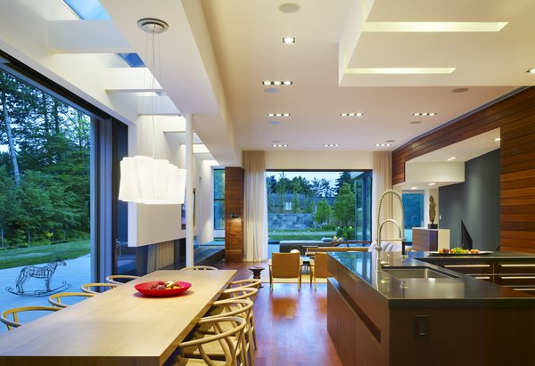 A minimal kitchen features Mid-Century furniture and lighting to create a welcoming family space.  Photo 5 of Davis Residence modern home