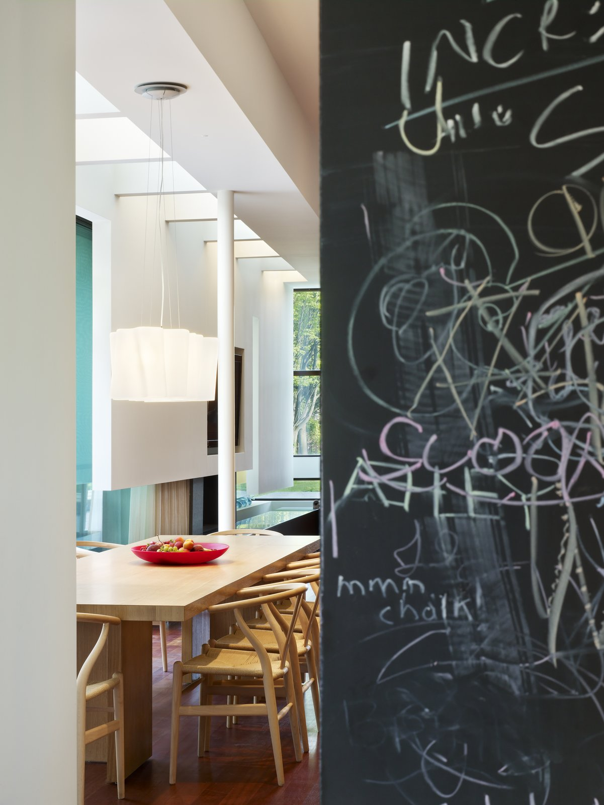 A chalkboard wall adds playfulness to the communal kitchen area.   Davis Residence by Abramson Teiger Architects