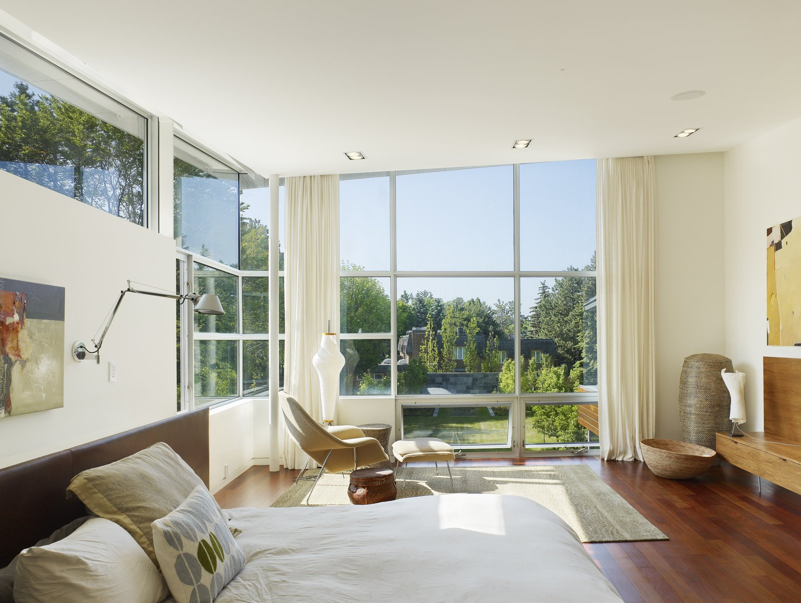 Upstairs, the airy bedrooms open to a central hall with a sitting area, lit by clearstory windows and finished with crisp white walls.  Davis Residence by Abramson Teiger Architects
