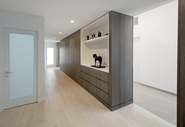 The color palette and grey wood finishes are carried throughout the home for a clean consistency.  Photo 7 of Glenhaven Residence modern home