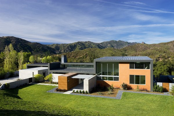 The compound consists of the main house building and the garage and guest room building, which are separated by a courtyard.  Photo  of Lima Residence modern home