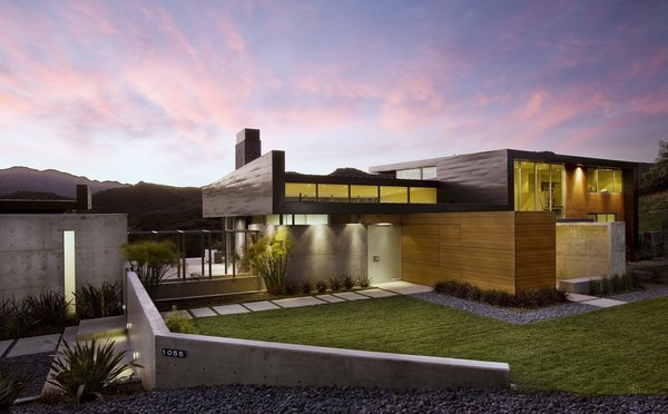 A mix of exterior materials mimic the earthy colors of the canyon.  Photo 2 of Lima Residence modern home