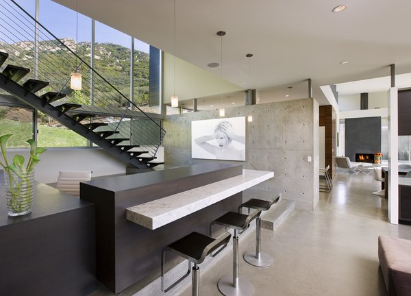 Concrete walls add an industrial touch to the polished home.  Photo 6 of Lima Residence modern home