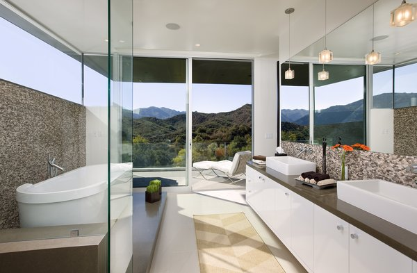A stunning bathroom opens onto a patio for striking canyon views.  Photo 8 of Lima Residence modern home