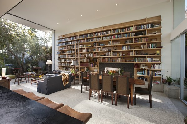 The homeowner possessed a brilliant collection of books, which are showcased in sprawling built-in book shelves in the living room.   Photo 7 of Goodman Residence modern home