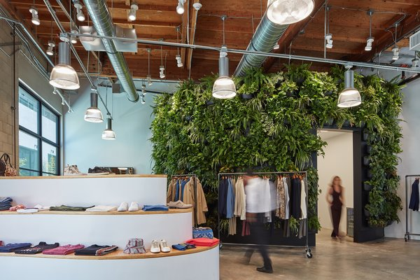 Industrial elements are embraced throughout the various retail stores.  The Abramson Teiger Architects design team balanced raw grit with a sprawling green in popular men's boutique Magasin.  Photo 9 of PLATFORM modern home