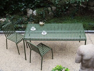Bouroullec Studio also presented a 13-piece outdoor collection called Palissade, made of powder-coated steel in a forest green shade.