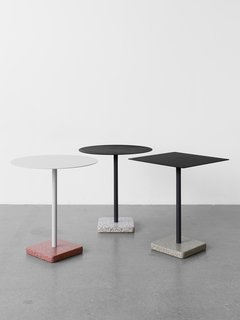 A distinctive terrazzo base is the defining feature of this Daniel Enoksson–designed table, appropriate for indoor or outdoor settings.