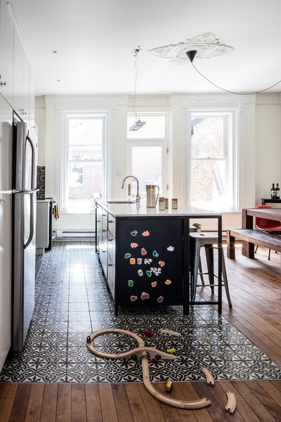 The first floor of this house, built in1885 and located in the McGill neighborhood of Montreal, was the perfect spot for a large kitchen and living area, which was missing from the old layout—a makeshift kitchen was previously located on the floor above. The clients, a web developer and a jewelry designer with a son, wanted a centralized space for eating and entertaining. The kitchen island contains three cabinets from IKEA, retrofitted with custom doors, as well as a dishwasher.