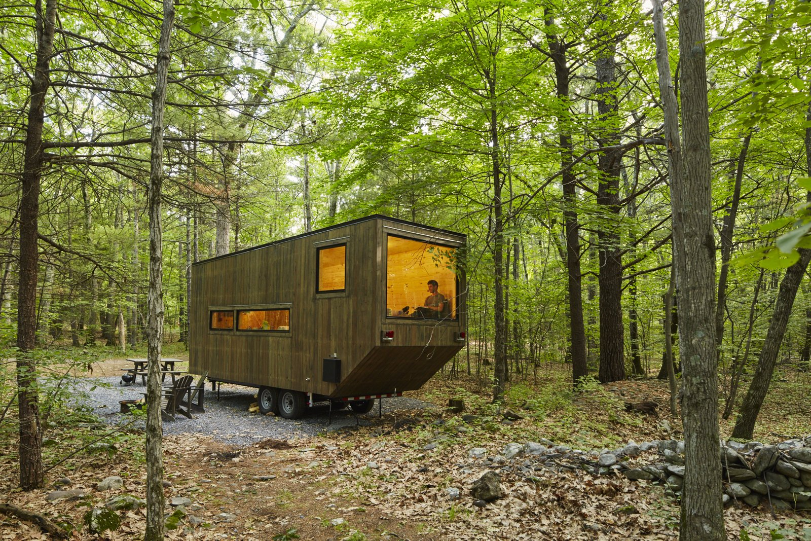 A large window is the focal point of the wheeled dwelling. Cabin by DAVE MORIN