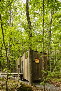 Forgo the Tent and Give a Tiny House a Test Drive - Photo 4 of 6 - The Isidore cabin sleeps four.