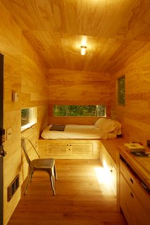 Forgo the Tent and Give a Tiny House a Test Drive - Photo 5 of 6 - The cabin comes equipped with board games and books.