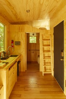 The Isidore cabin has a sleeping loft with a clerestory window.