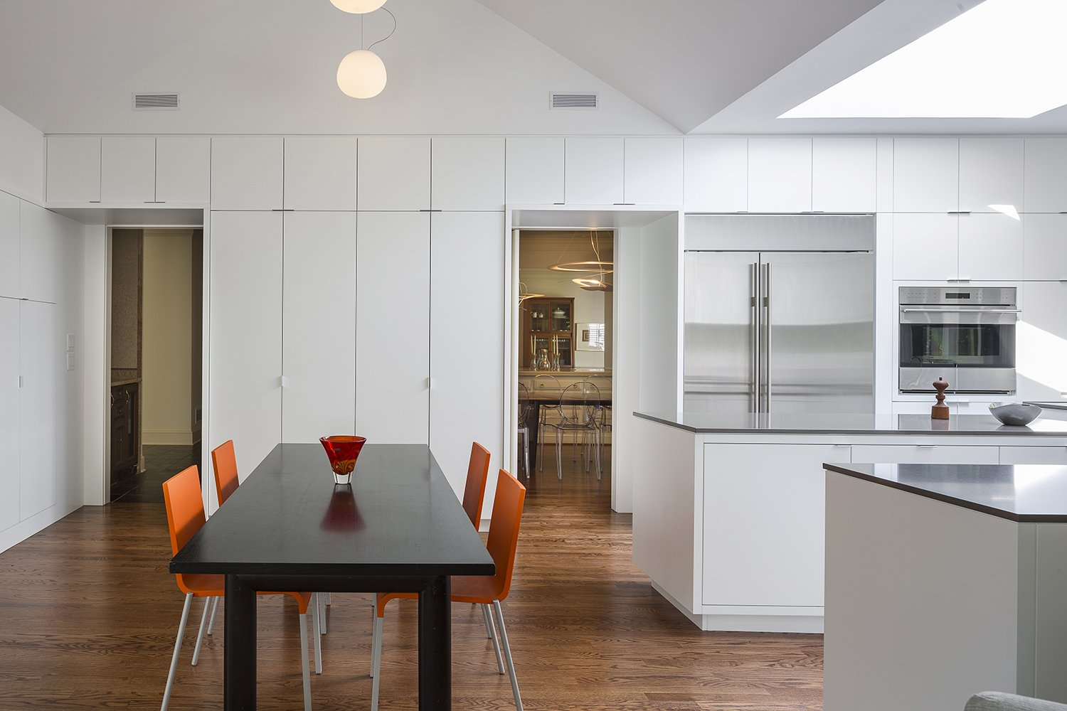 In Leawood, Kansas, Forward Design | Architecture redesigned a kitchen and family room in a traditional home, creating a bright and minimalist space that takes cues from the residents' contemporary furnishings.